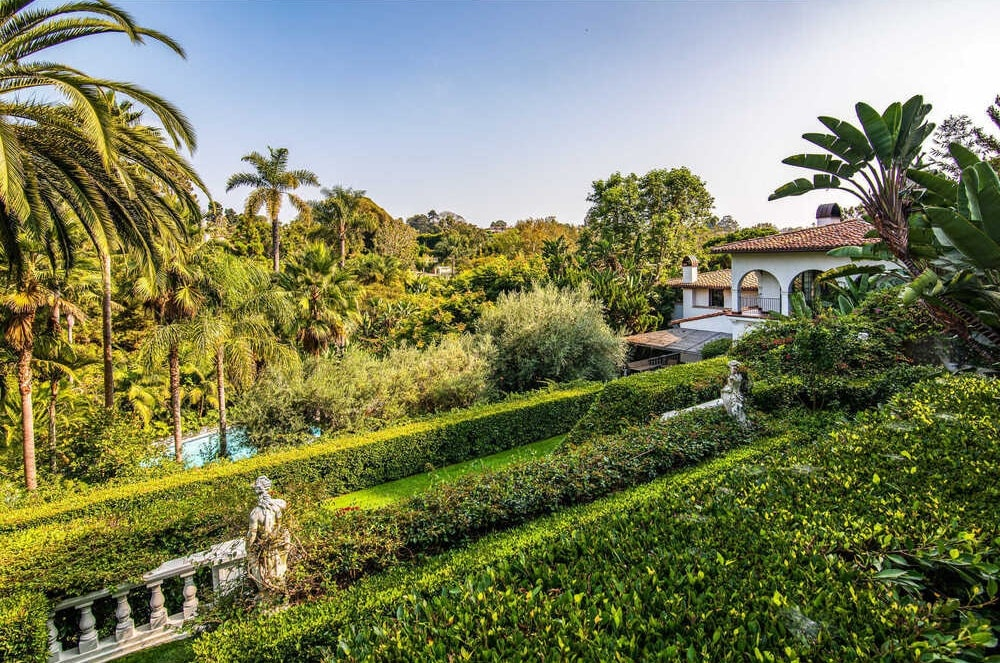 This view of the garden showcases the terraced design of the area with rows of shrub hedges and concrete structures. Image courtesy of Toptenrealestatedeals.com.