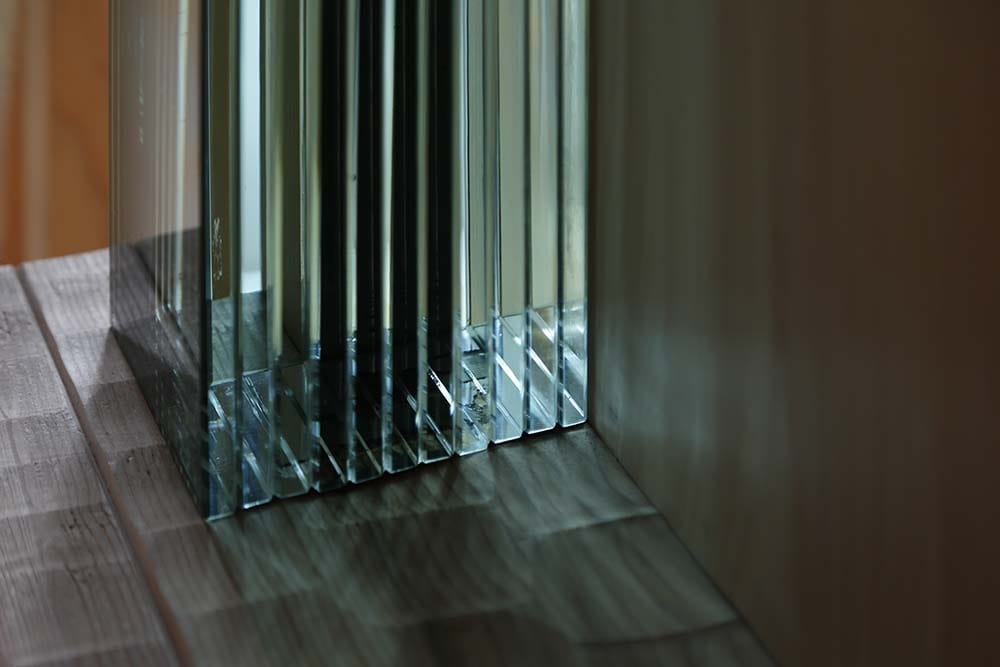 This is a close look at the bottom of one of the pillars accented with layers of glass.