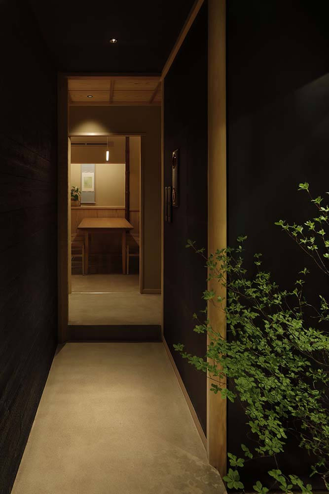This black wooden wall is like a hidden doorway that opens to the restaurant.
