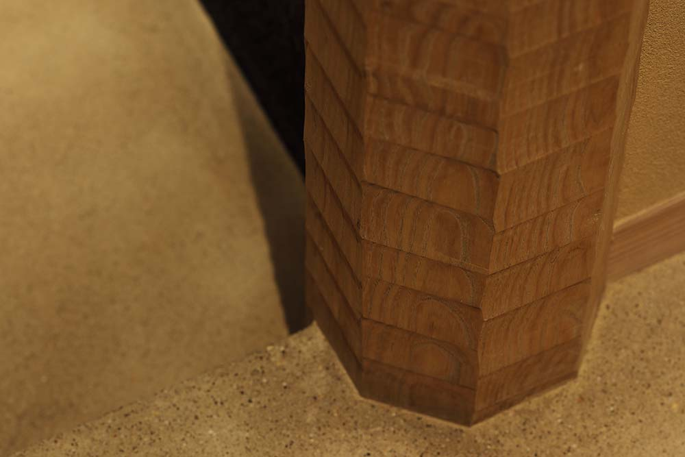 This is a close look at the flooring and the edge of the wooden pillar.