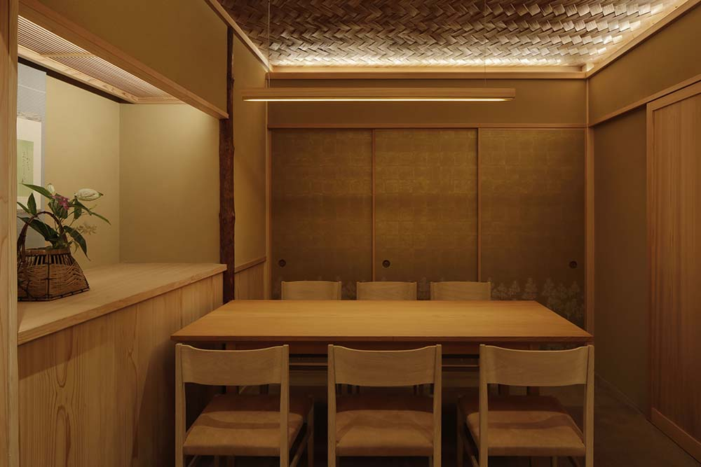 This is another look at the dining area, its rectangular wooden dining table and the surrounding wooden chairs.