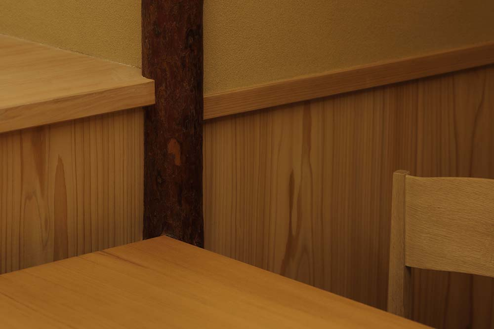 This is a close look at the wooden accents of the walls of the restaurant matching with the dining table.