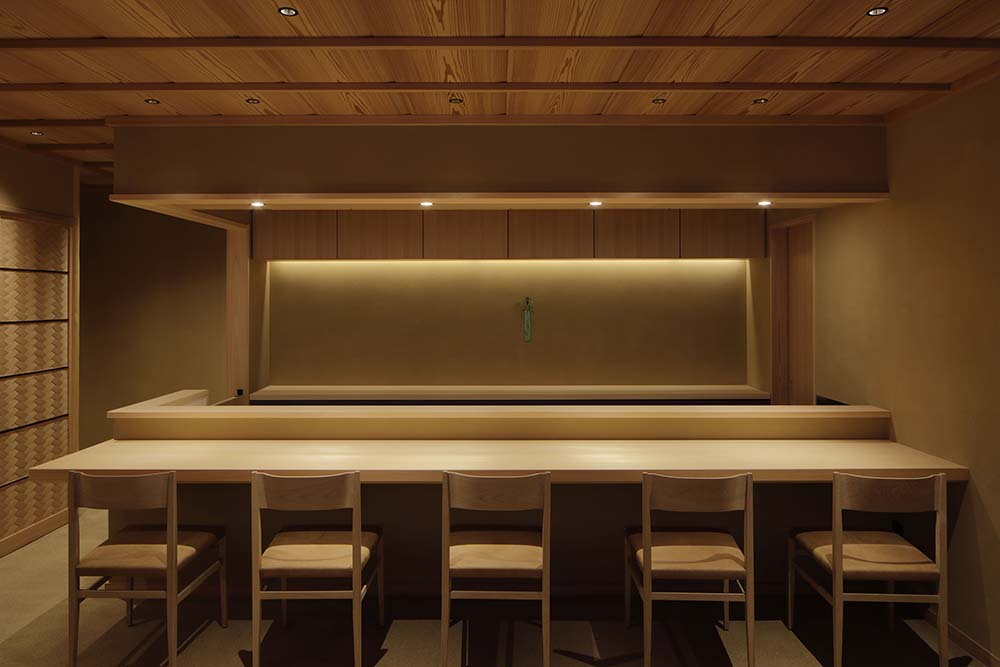 This is a look at the large food preparation area with modern lighting that pairs well with the wooden elements.