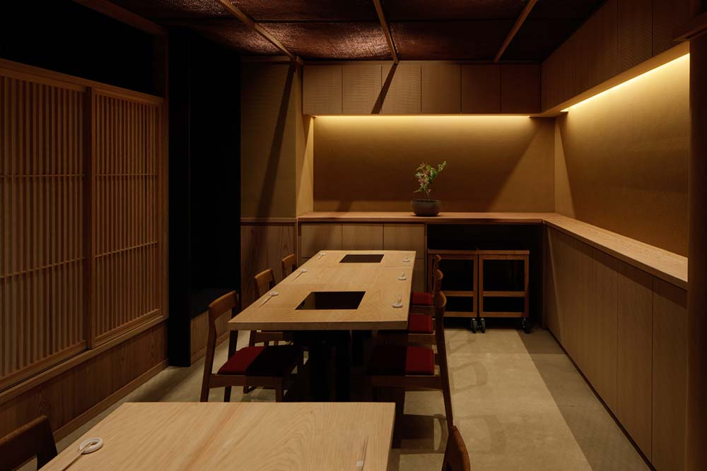 This is another room with enough space for two long rectangular dining tables.