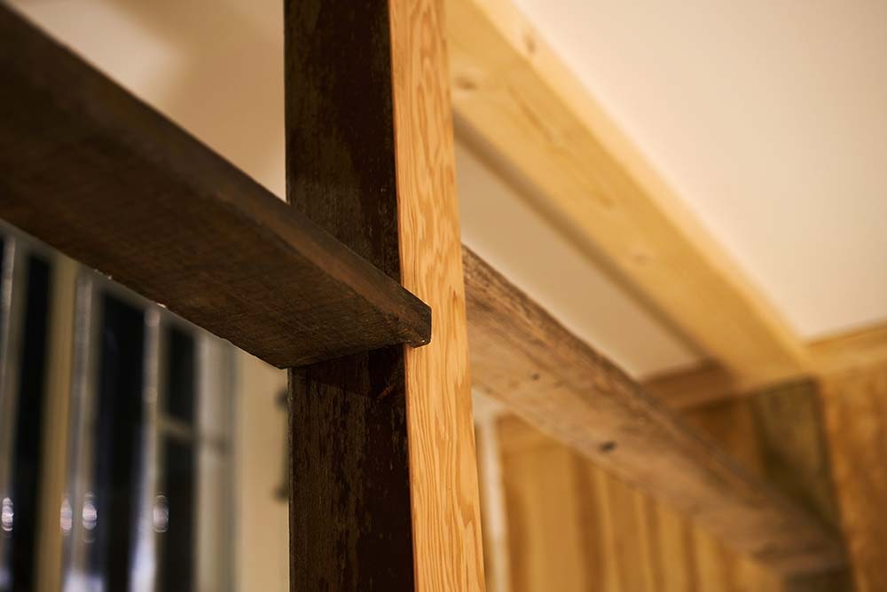 This is a close look at one of the thick wooden beams and pillars that support the area.