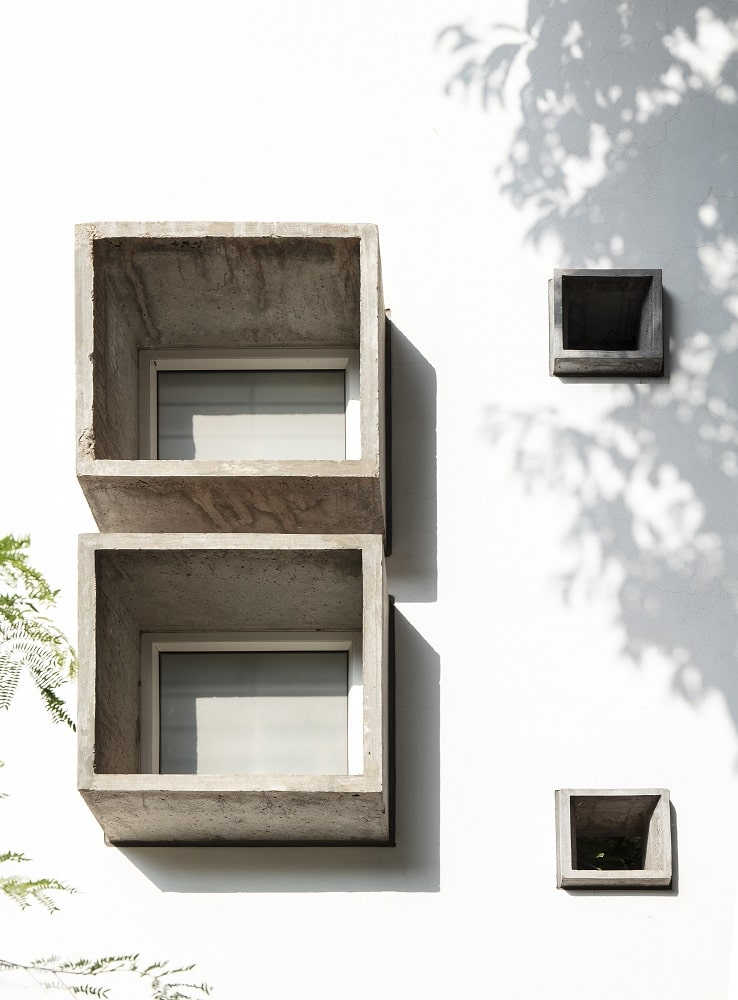This is a close look at a few windows with concrete structures making the windows stand out.