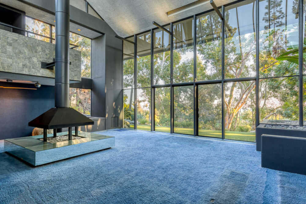 This is another look at the living room that is brightened by the abundance of natural lighting that goes in through the tall glass walls. Image courtesy of Toptenrealestatedeals.com.