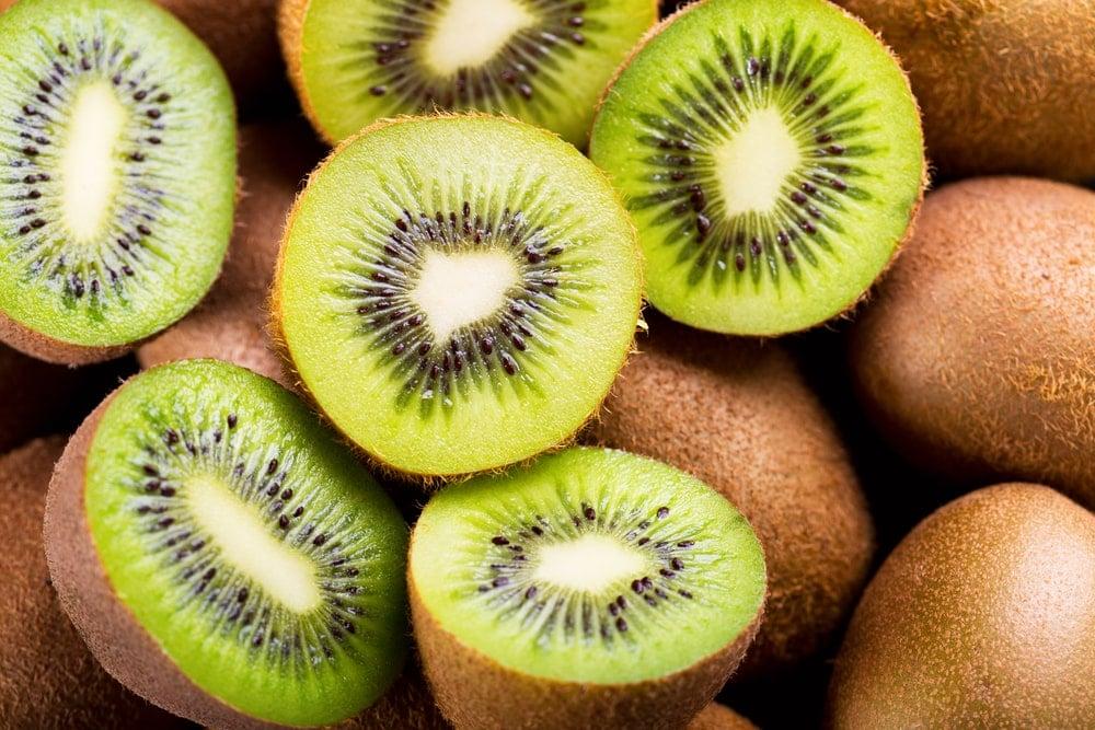 A close look at a bunch of kiwi fruits.