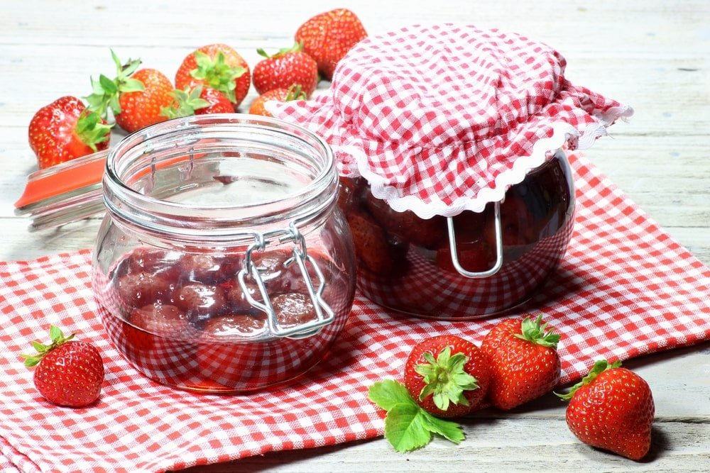 A close look at a couple of home made canned strawberries.