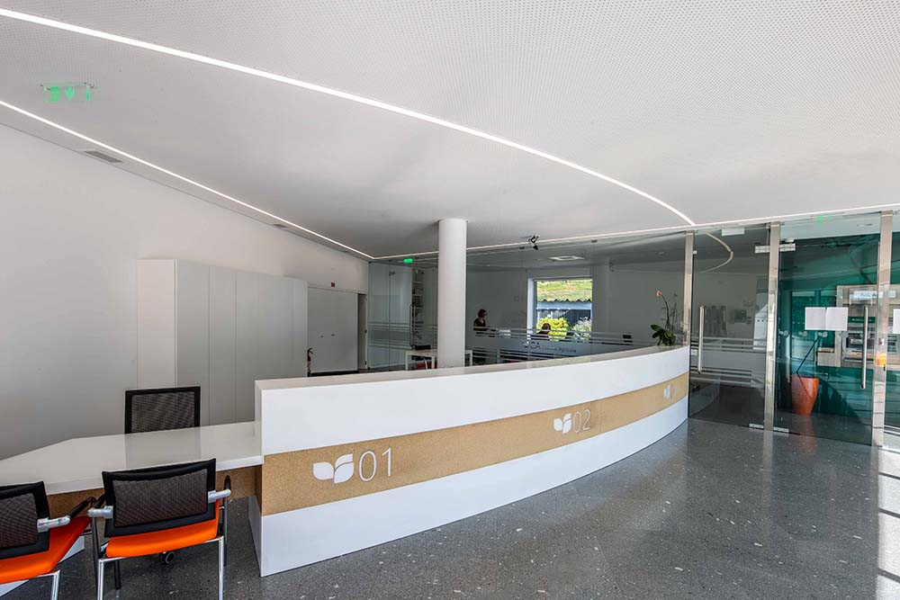 This is a close look at the bank's lobby and reception desk with a curved design.