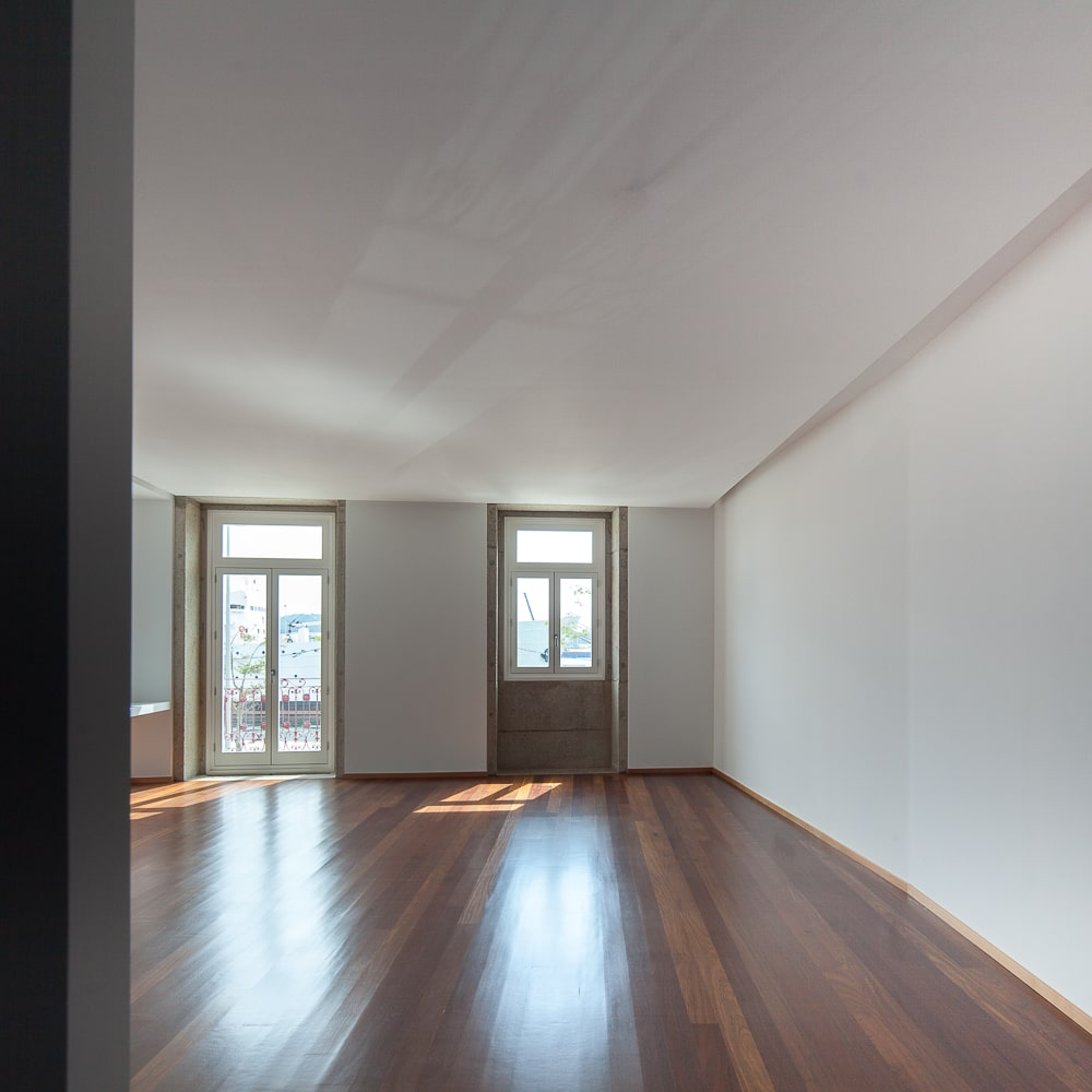 This interior view of the house showcases the spacious hardwood flooring.
