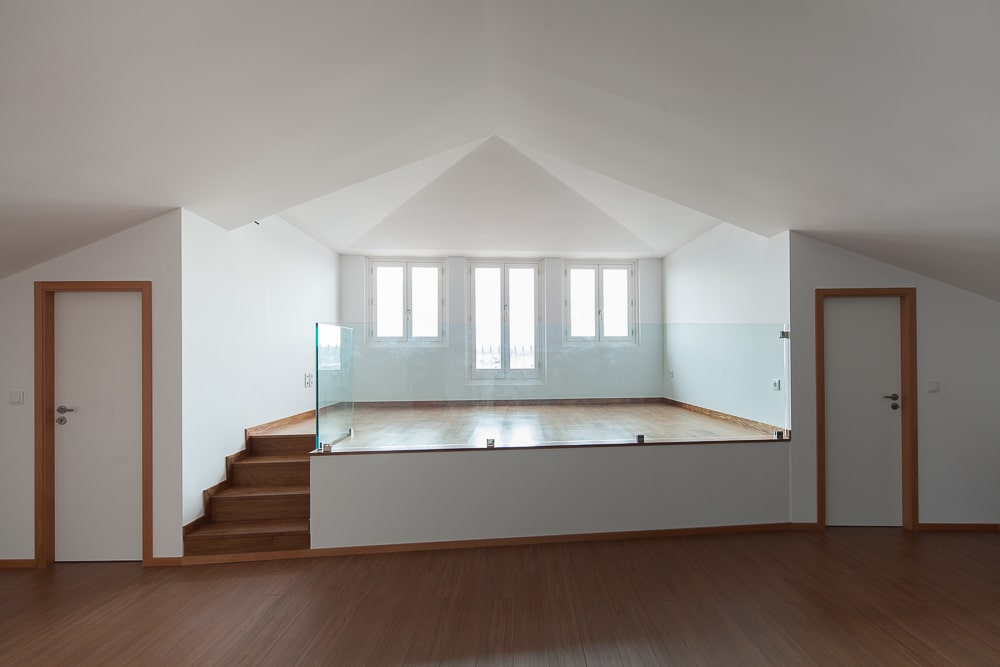 This area of the house has a platform elevated area bordered with glass wall perfect for a playpen or a living room.