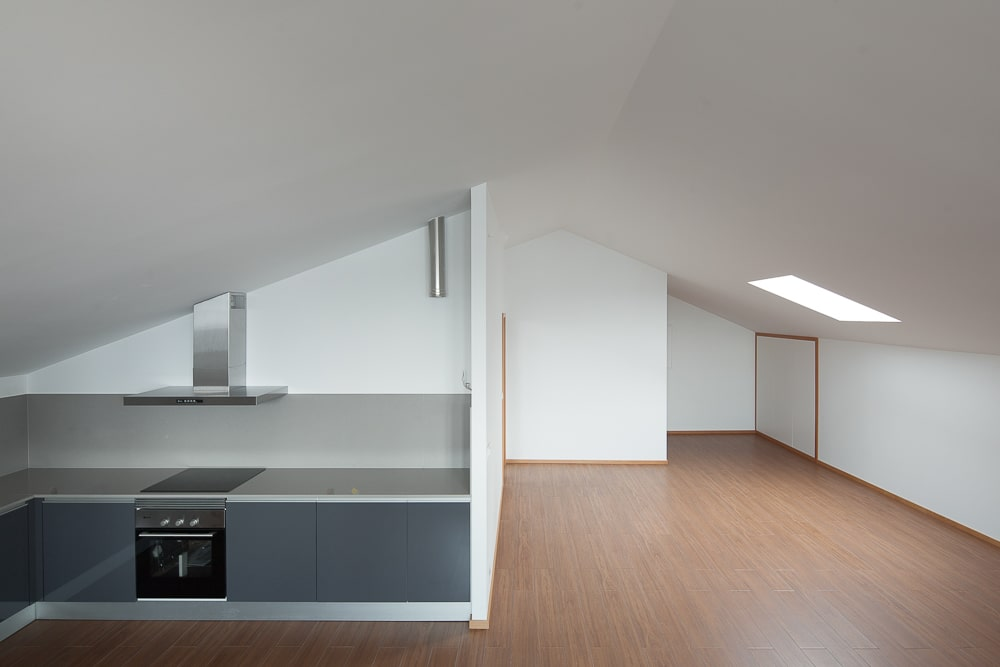 This upper floor has a low cathedral ceiling and spacious hardwood flooring brightened by the white walls.