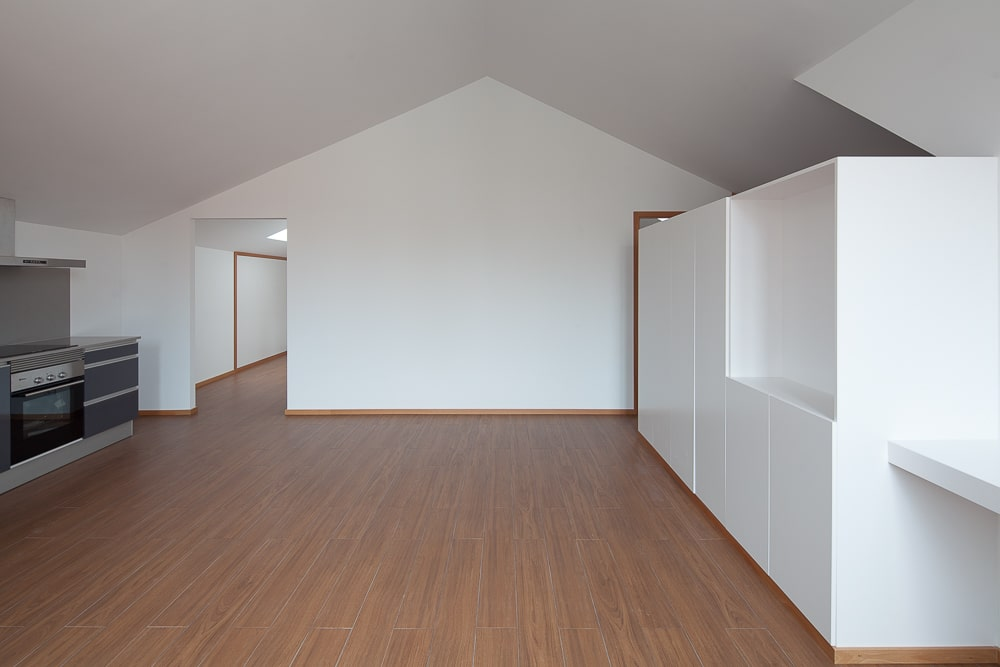 This is the area across from the kitchen with enough space for a large dining area.