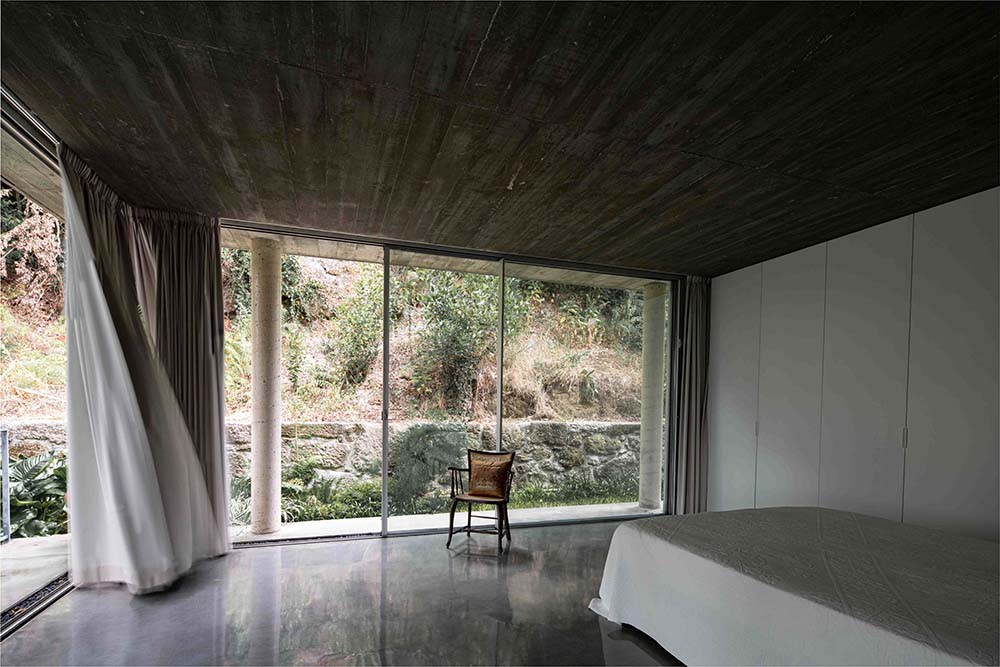 These glass walls bring in an abundance of natural lighting for the bedroom.
