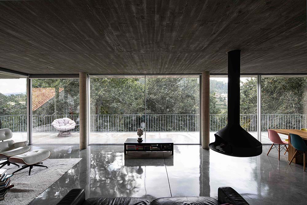 This is another view of the living room showcasing a floating modern fireplace.