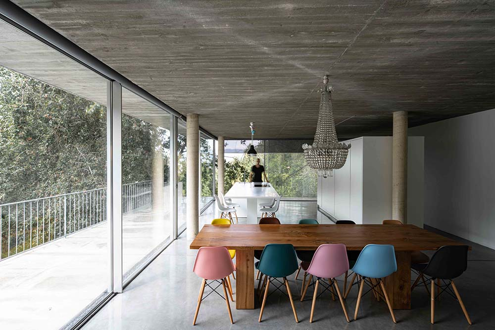 This is another look at the dining area showcasing the various colorful chairs.