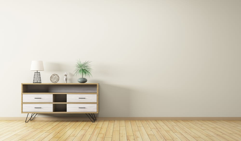 This is a small wooden console cabinet with built-in shelf and drawers as well as simple and thin stands.