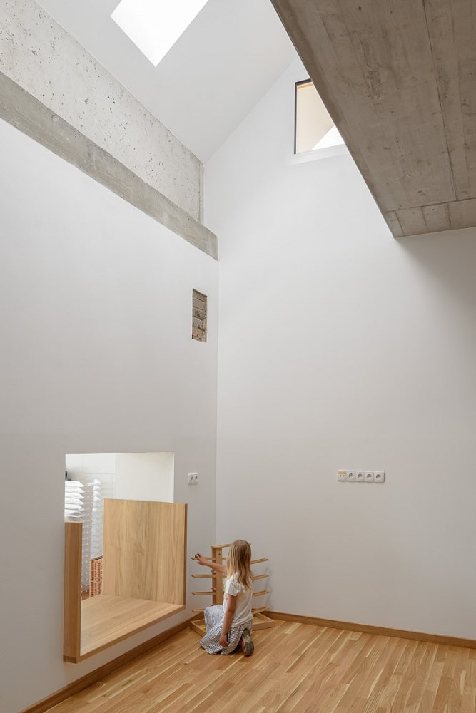 The tall ceiling of the classroom also has a skylight to add to the natural light that brightens the light walls.