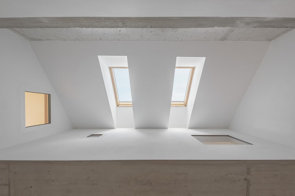 This is a close look at the pair of skylights that bring in natural lighting for the room.