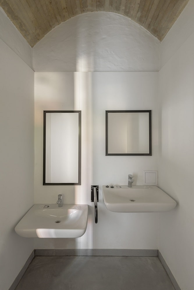This is a close look at a bathroom with two separate sinks for different height.