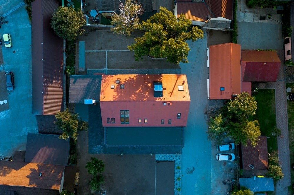 This is an aerial view of the kindergarten with its two structures and red clay tile roofs.