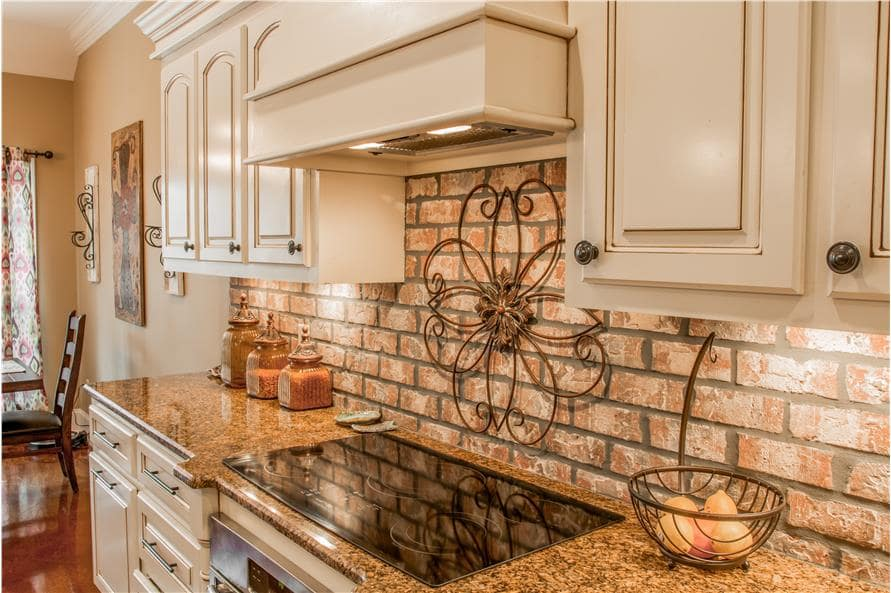 Granite countertops and a built-in cooktop complete the kitchen.
