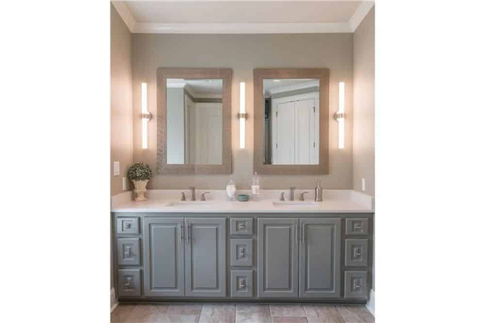 Bathroom with a gray vanity equipped with double sinks and chrome fixtures.