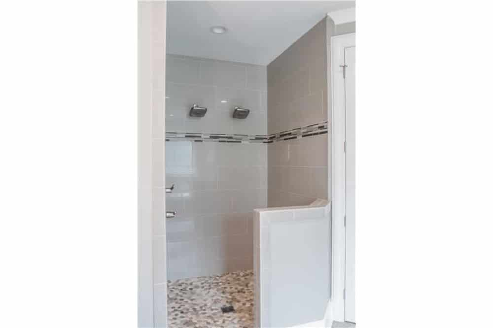 A walk-in shower with double shower heads completes the bathroom.