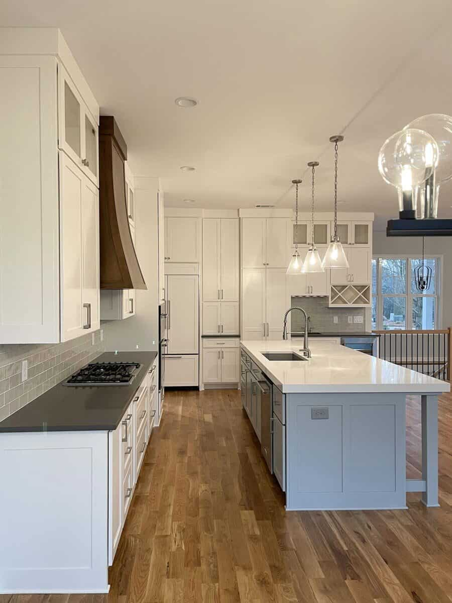 The kitchen island is fitted with an undermount sink and a gooseneck faucet.