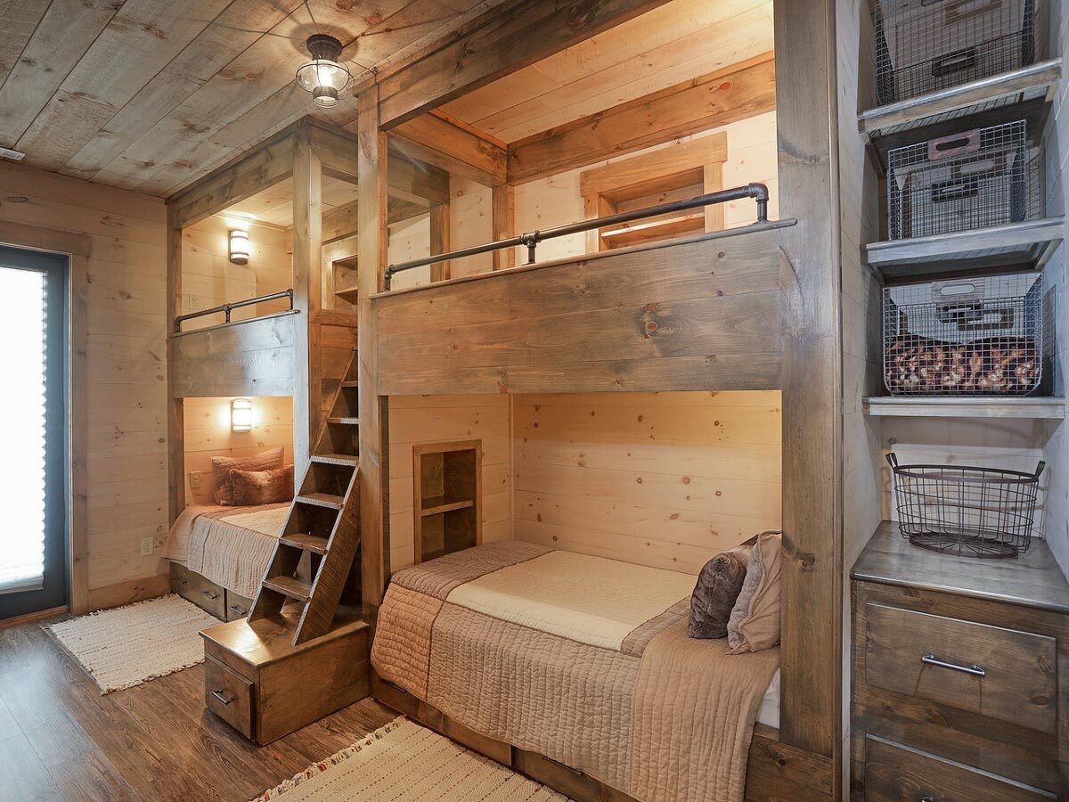 Heavy wood elements run throughout this bunkroom.