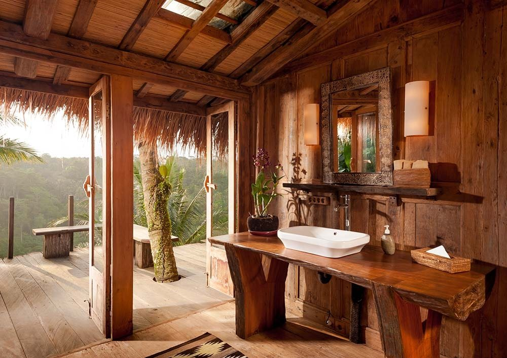 The bathroom has a rustic wooden vanity topped with a porcelain sink and mirror.