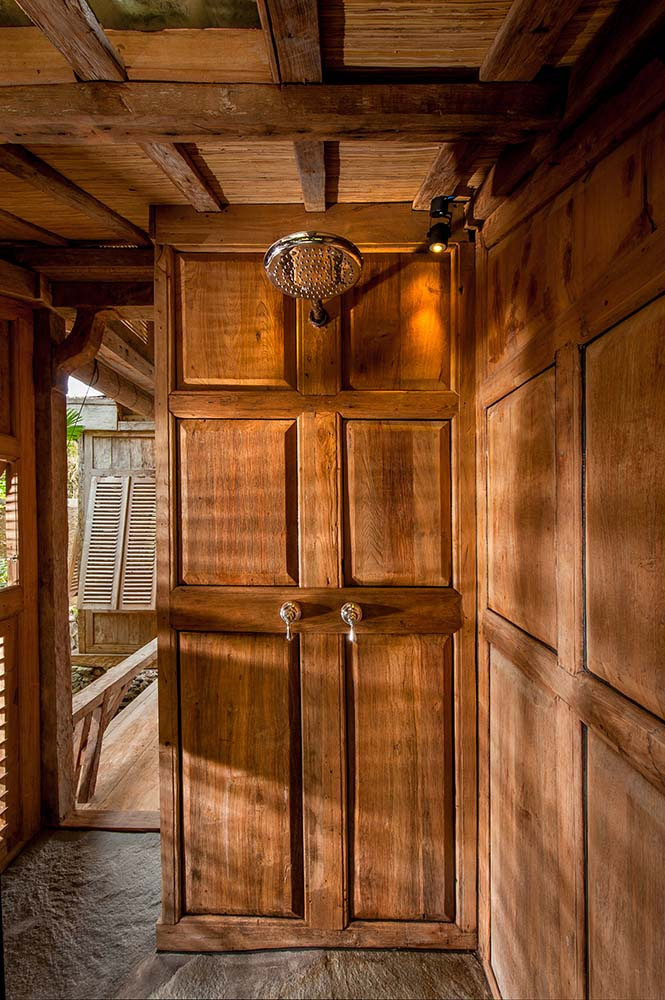 This is a close look at the wooden door of the bedroom with patterns and designs.