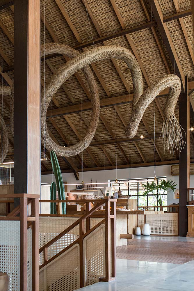 This is a close look at the large woven wicker structure and artpiece hanging above the reception desk.
