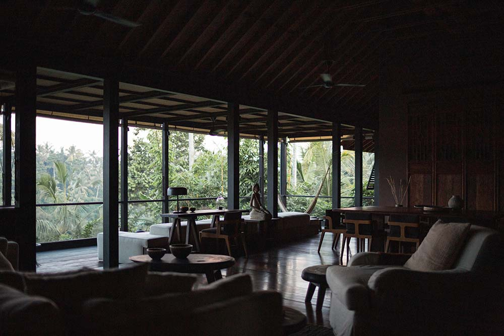This is a view of the living room showcasing the natural light coming in from the glass walls.