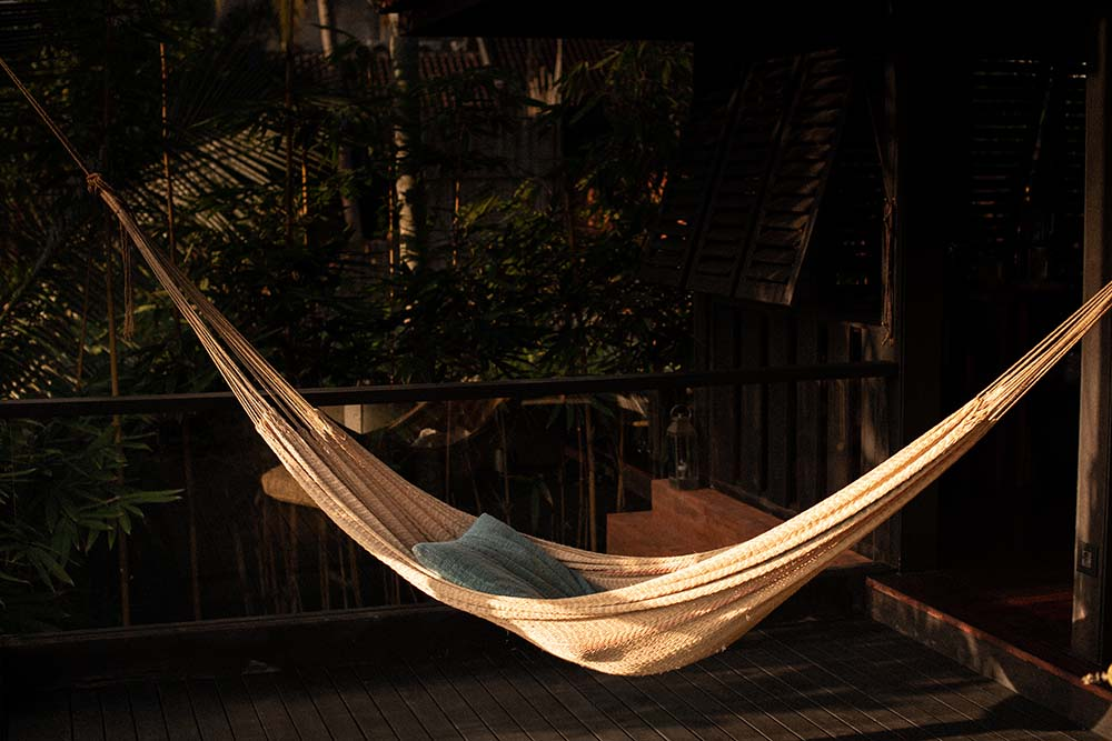 This is a close look at one of the balconies of the house fitted with a hammock.