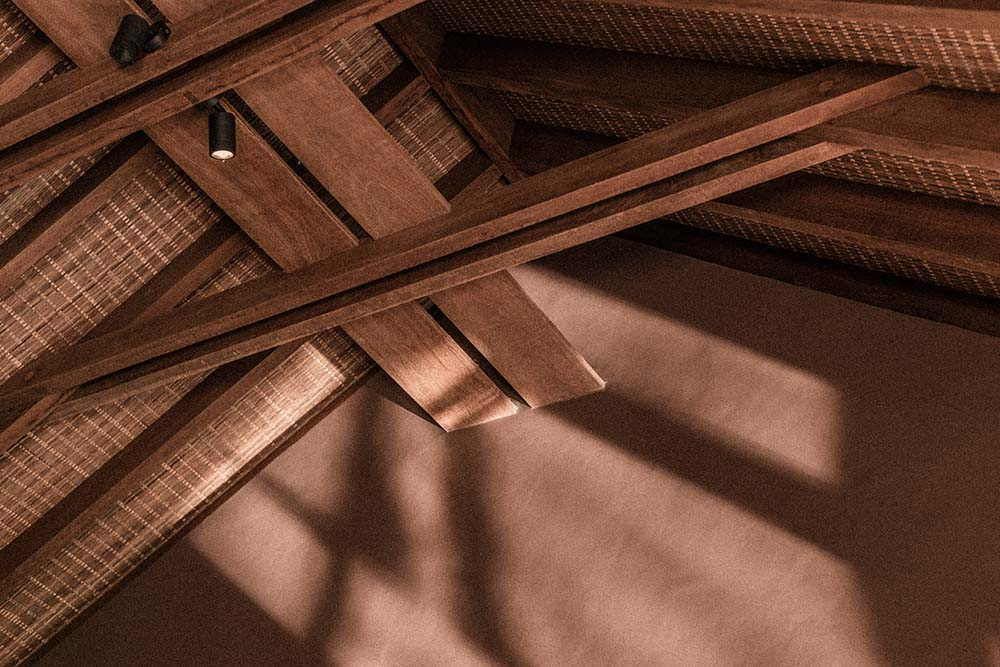 This is a close look at the exposed beams of the tall cathedral ceiling.