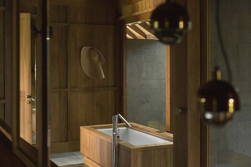 This is a closer look at the bathtub house with wooden elements that match the walls and ceiling.