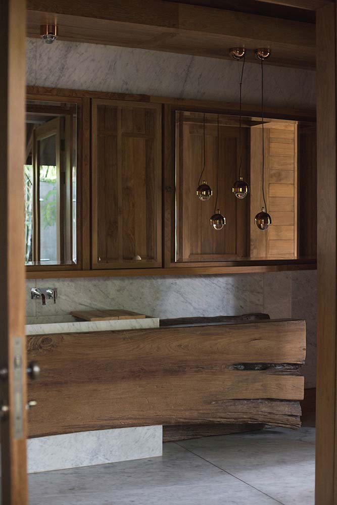 This is another look at the rustic large vanity made of wood from the vantage of the bathtub.