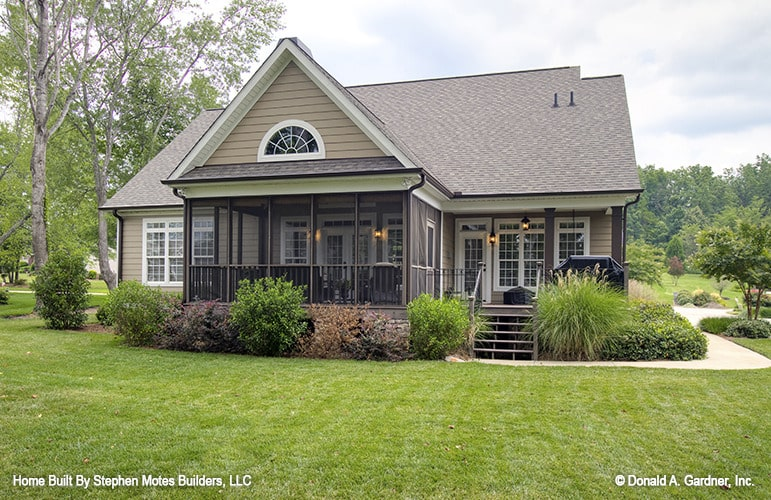 Rear exterior view with a screened porch and a covered deck framed with dark wood pillars.
