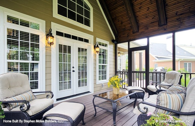 A white french door off the screened porch leads to the great room.