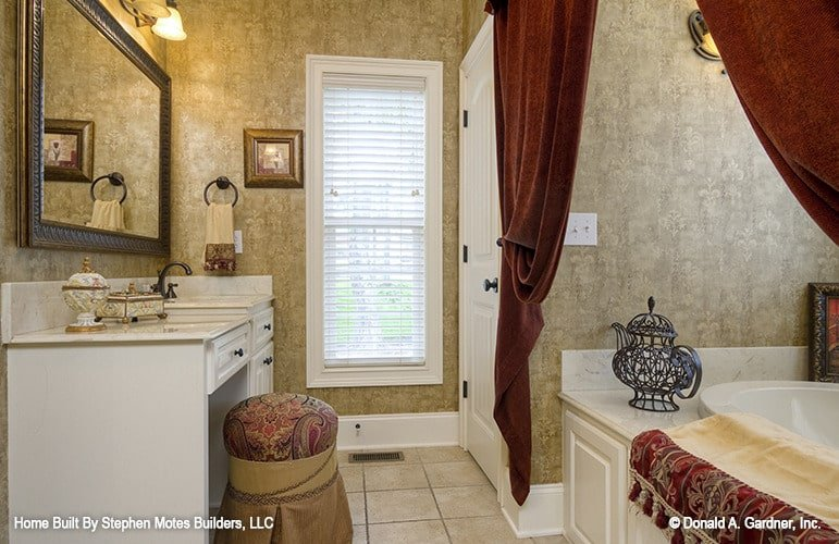 The primary bathroom includes a sink vanity with a makeup counter.