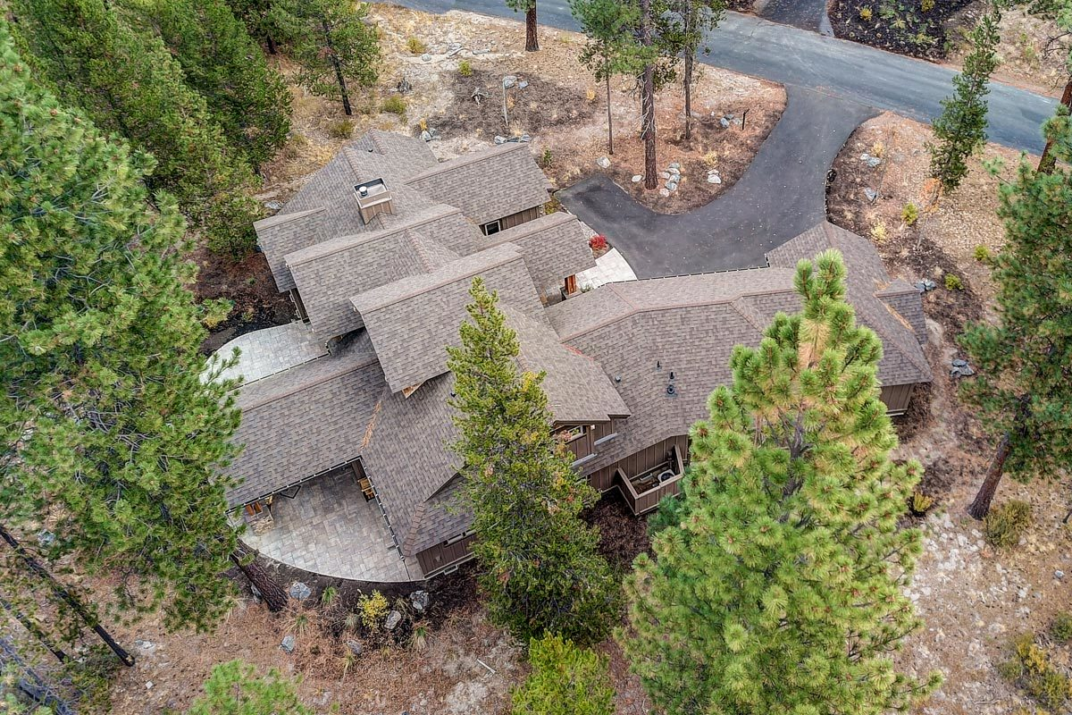 Aerial view of the mountain ranch home.