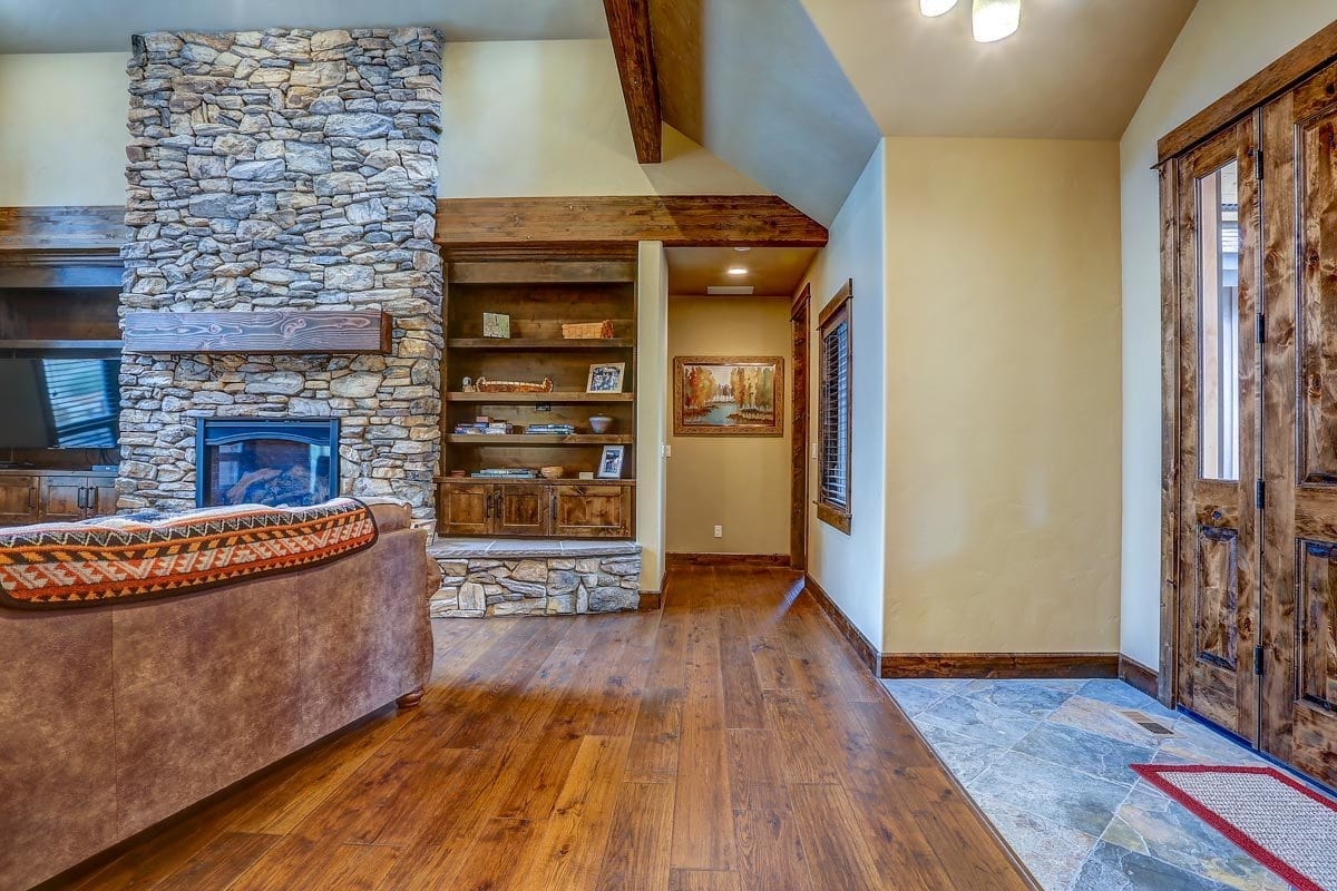 The foyer opens up to the vaulted living room.