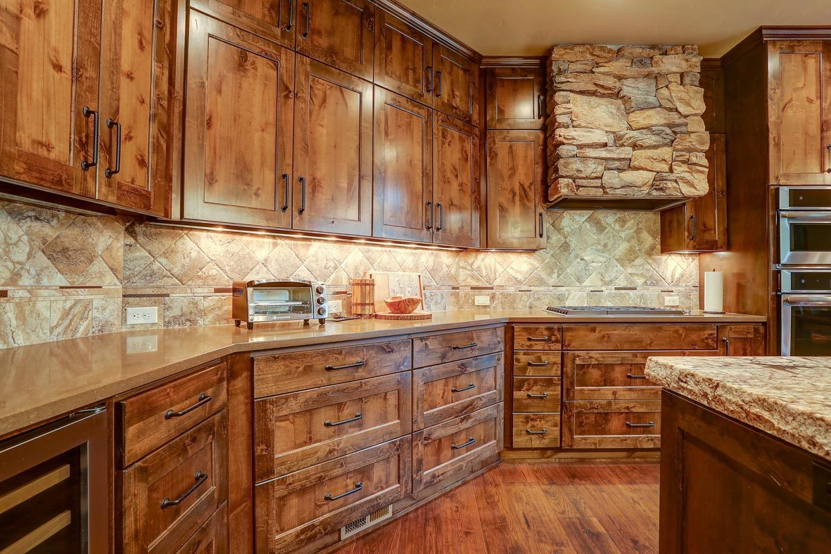 Granite countertops provide the kitchen with a great workspace.