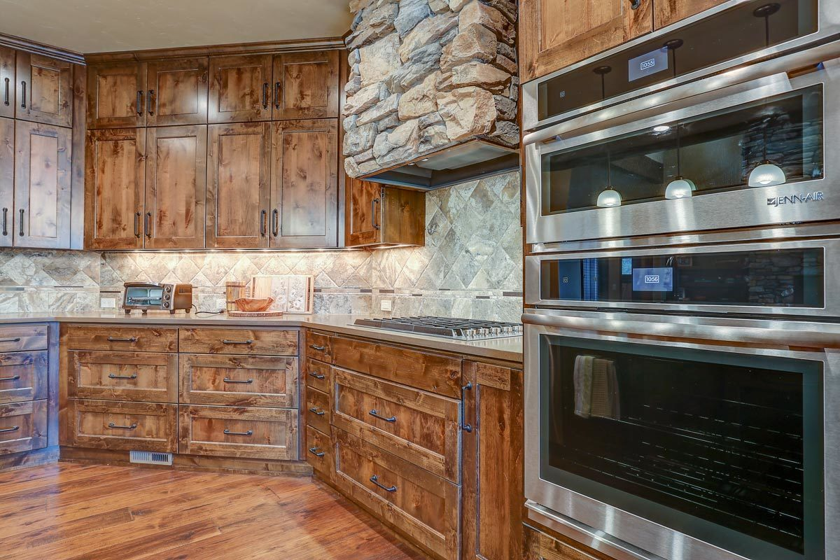 A closer look at the double wall oven fitted against the wooden cabinetry.