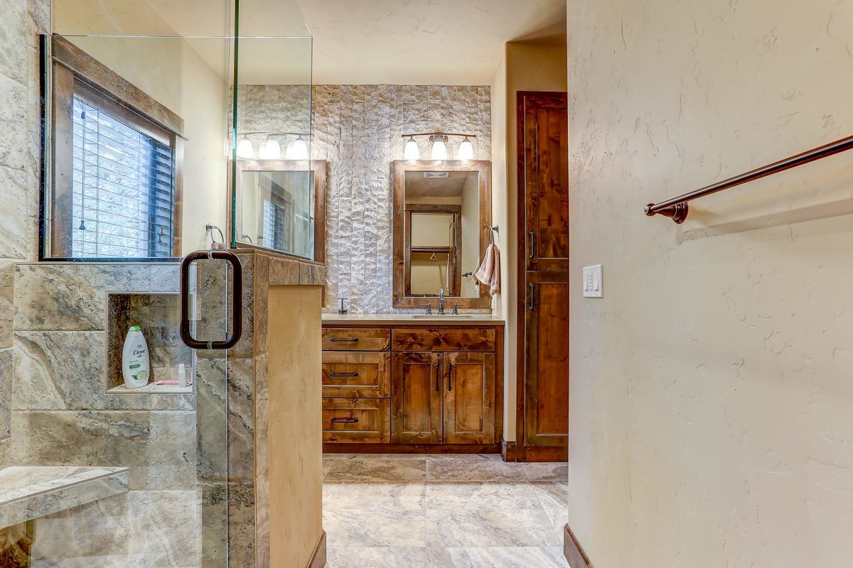 There's also a walk-in shower with glass panels and an inset shelf.