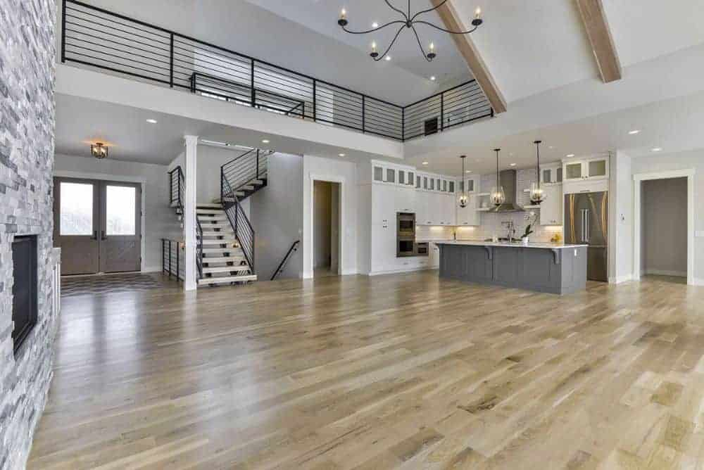 An open layout view showing the foyer, living area, and kitchen.