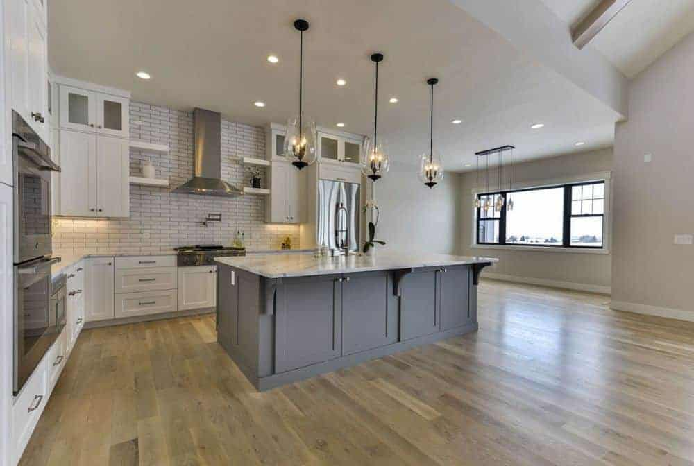 Recessed ceiling lights along with glass pendants illuminate the kitchen.