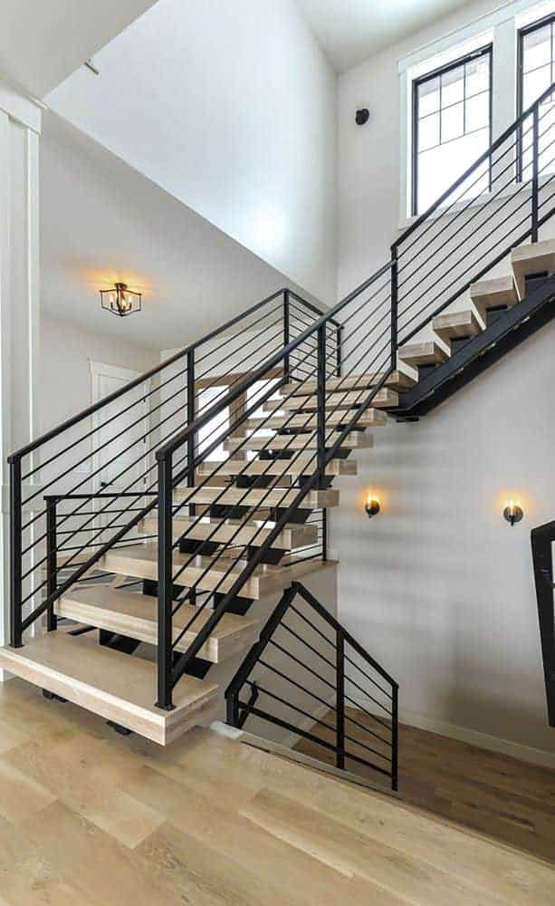 The staircase leads to the basement and upstairs bedrooms.